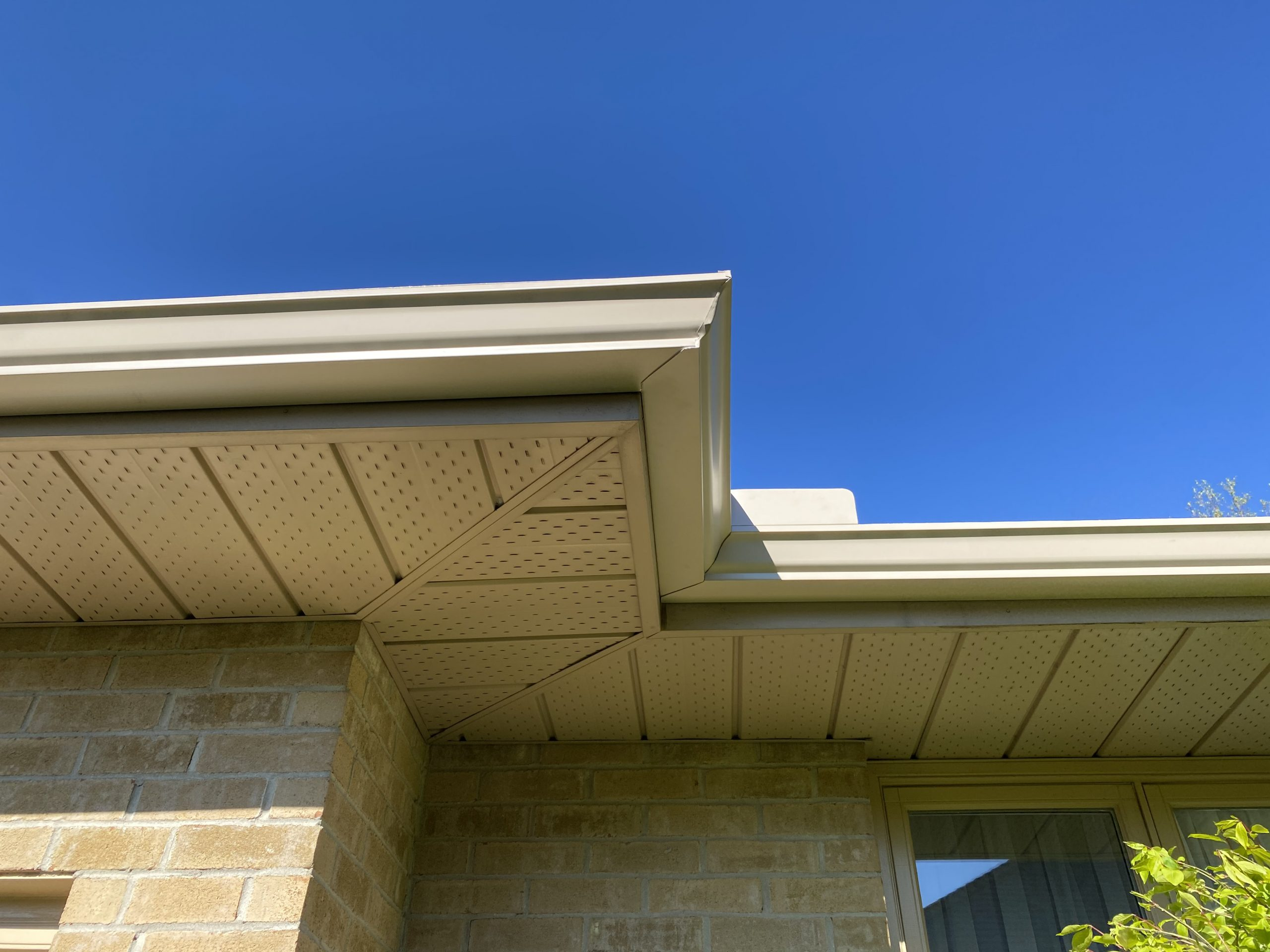 eavestrough framing roofline looking up below soffit