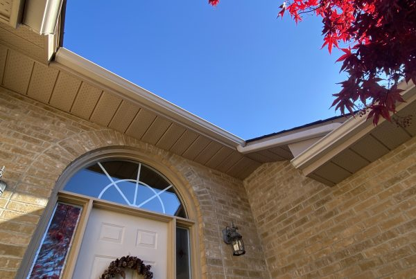 View of soffit & Fascia installation from below against bright blue sky
